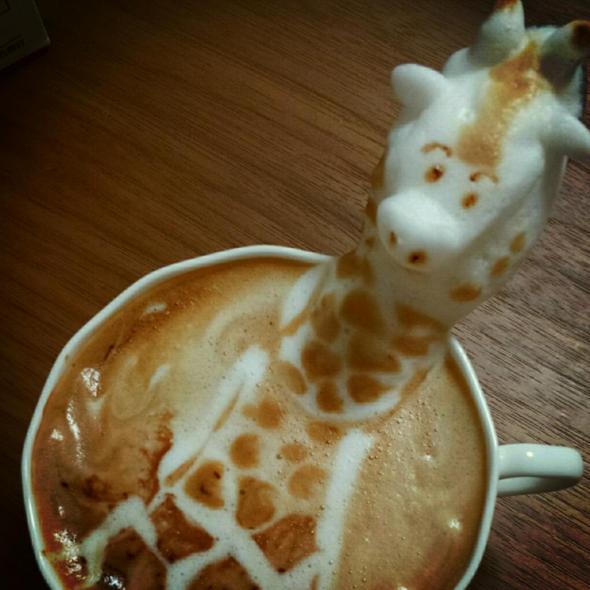 a-giraffe-is-bathing-in-your-latte