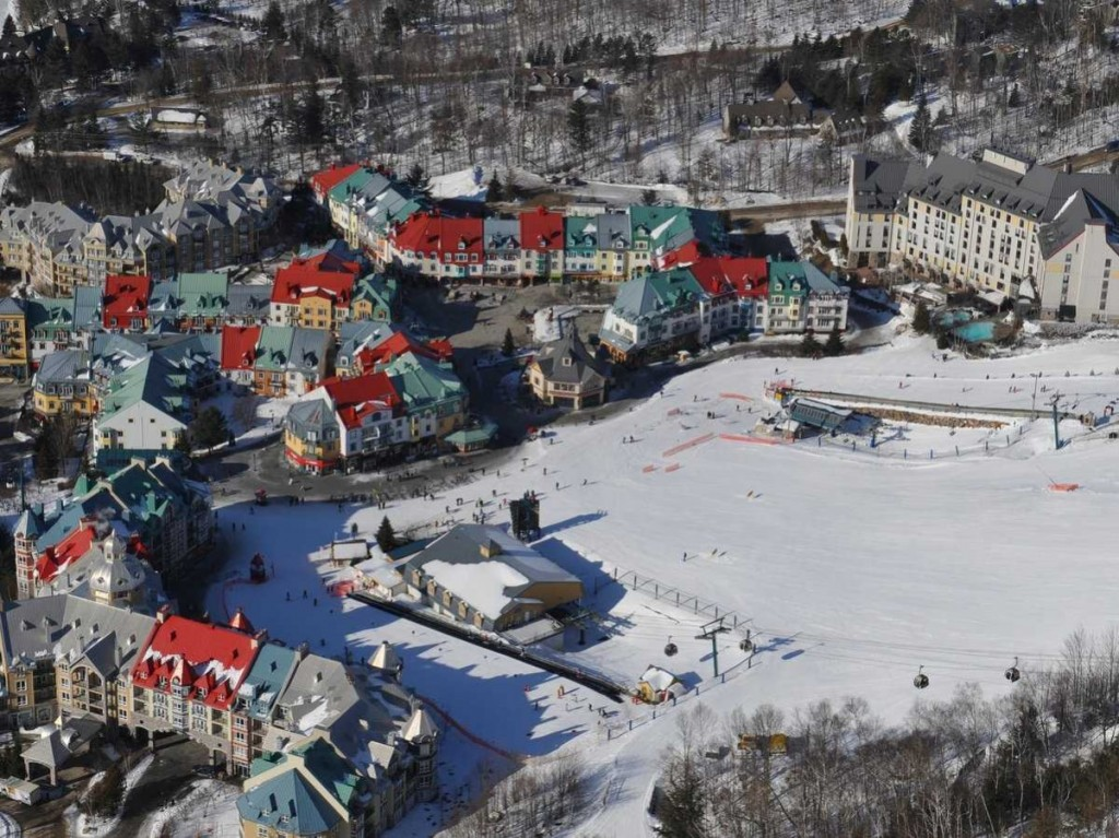 look-down-at-the-charming-french-canadian-village-of-mont-tremblant-from-the-top-of-the-mont-tremblant-ski-resort-in-quebec-canada-about-80-miles-north-of-montreal