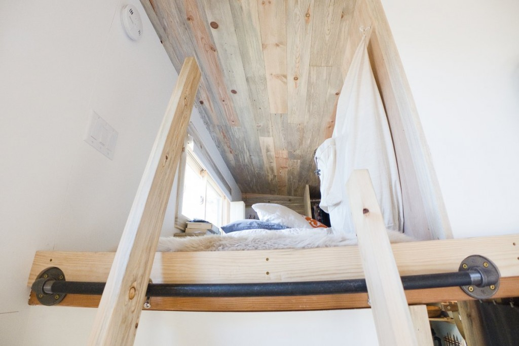 the-couple-climb-a-ladder-to-get-upstairs-to-the-bedroom