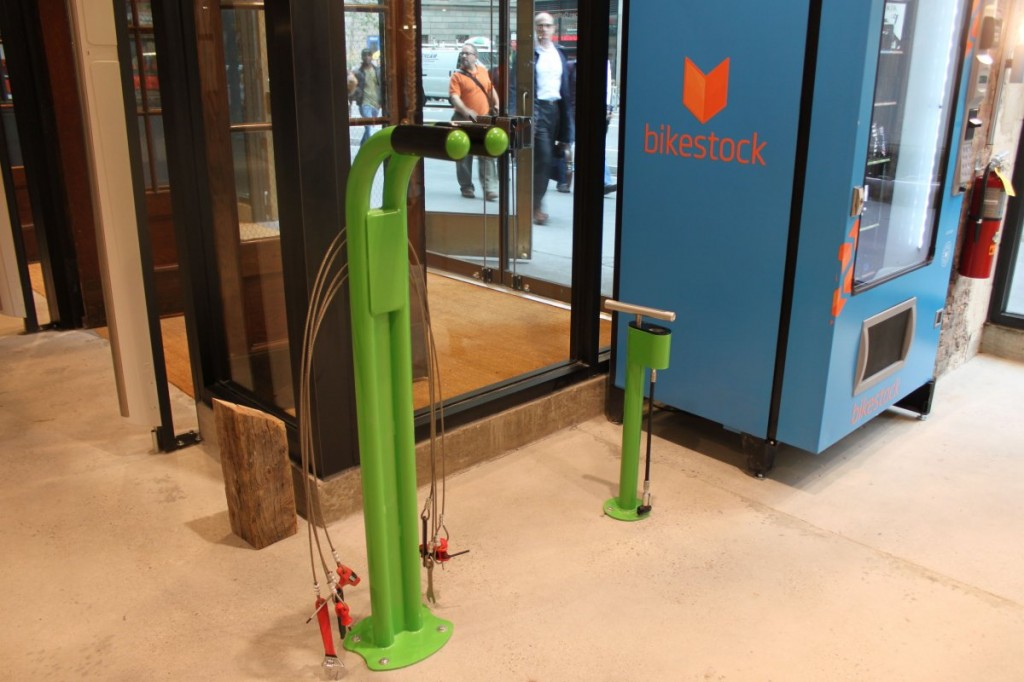 before-leaving-the-store-customers-can-make-quick-bike-repairs-the-vending-machine-pictured-sells-bike-parts-and-one-of-the-green-posts-is-an-air-pump-while-the-other-features-a-half-dozen-bike-tools