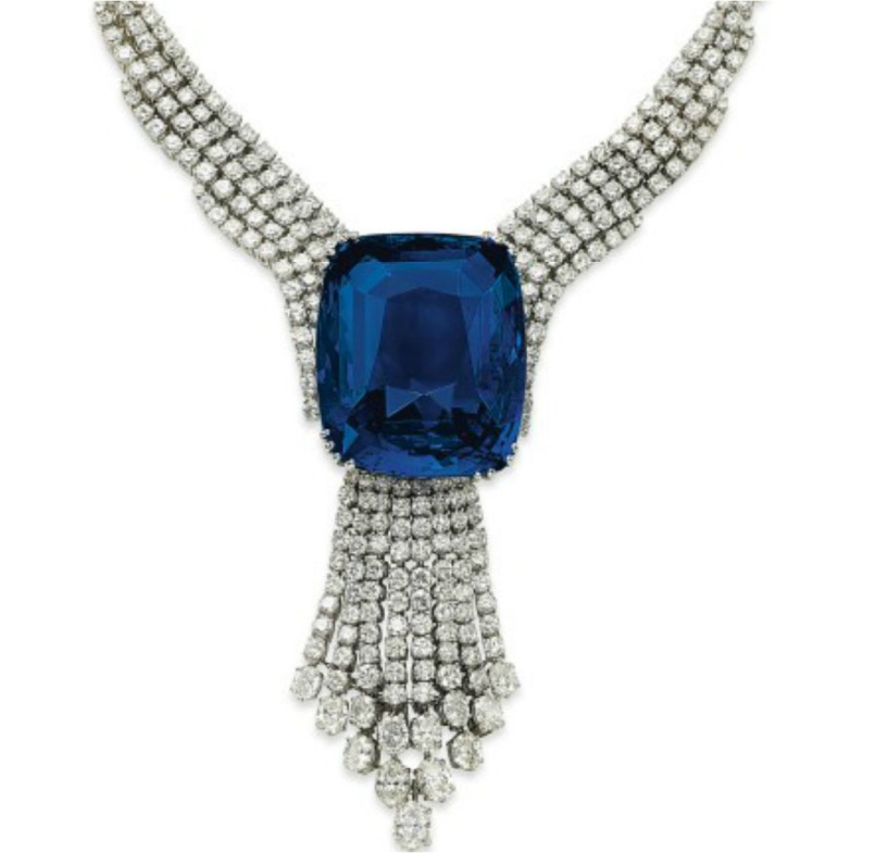 blue-belle-of-asia-with-diamond-tassel-pendant-suspended-from-it-in-a-diamond-necklace