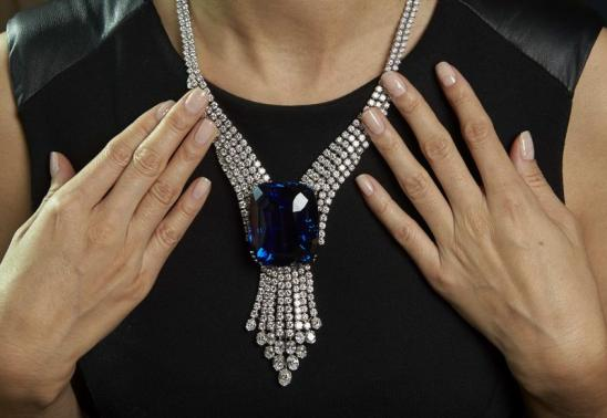 """File picture of a Christie's staff member wearing """"The Blue Belle of Asia"""" in Geneva"""