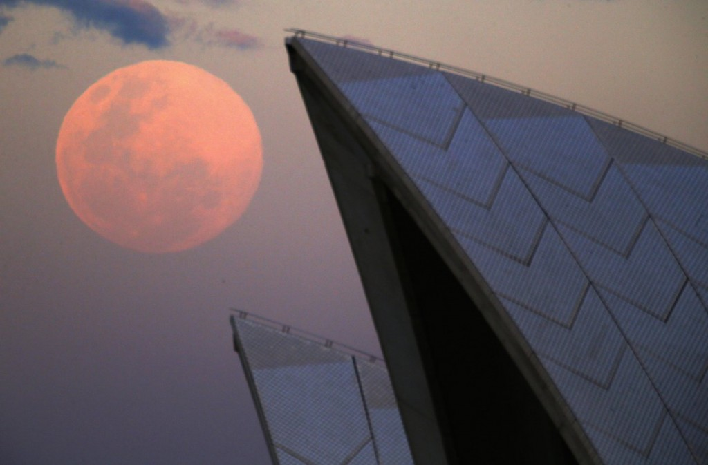 a-supermoon-rises-behind-the-roof-of-the-sydney-opera-house-august-10-2014-the-astronomical-event-occurs-when-the-moon-is-closest-to-earth-in-its-orbit-making-it-appear-much-larger-and-brighter-than-usual