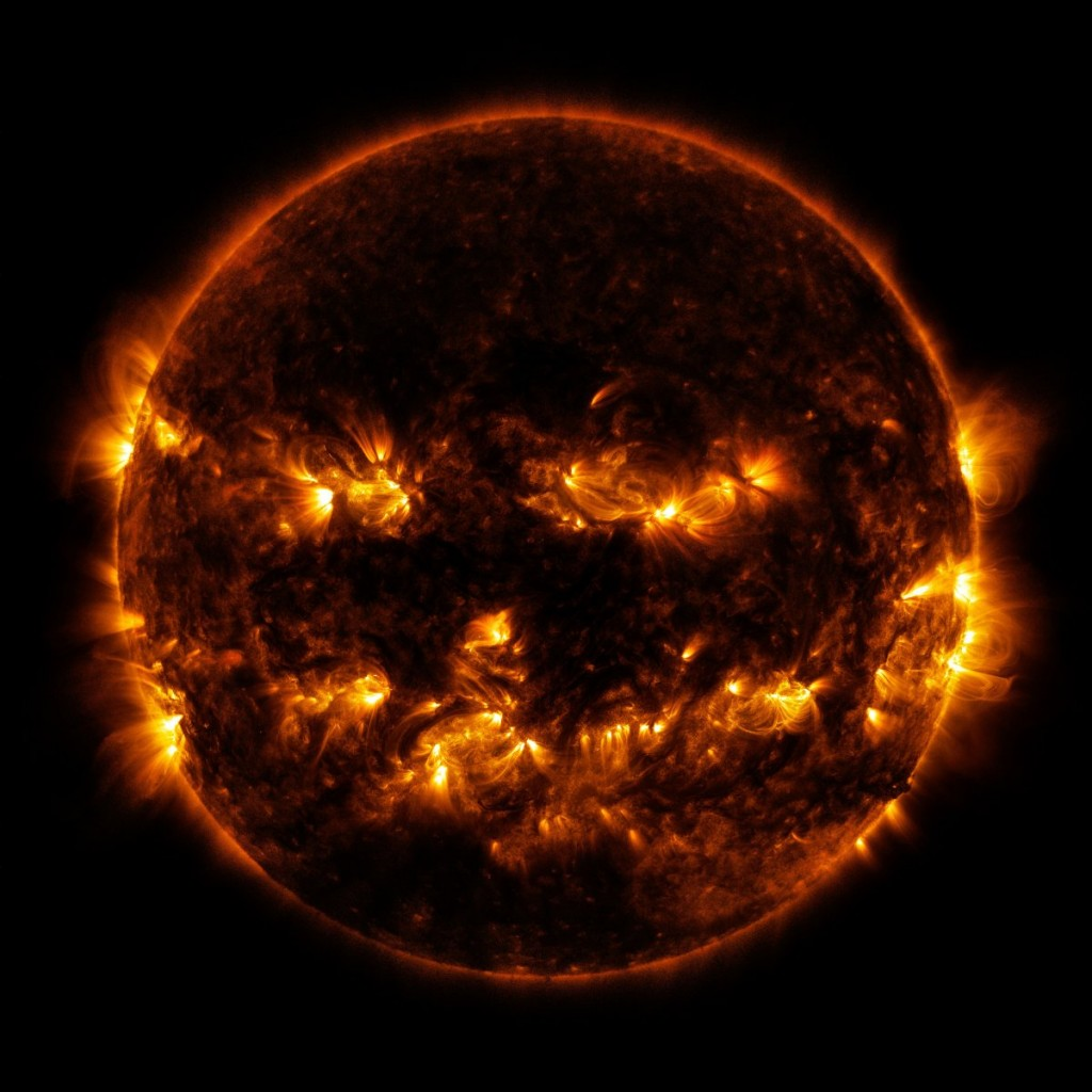 active-regions-on-the-sun-combine-to-look-something-like-a-jack-o-lanterns-face-as-pictured-in-this-image-provided-by-nasa-on-october-8-2014