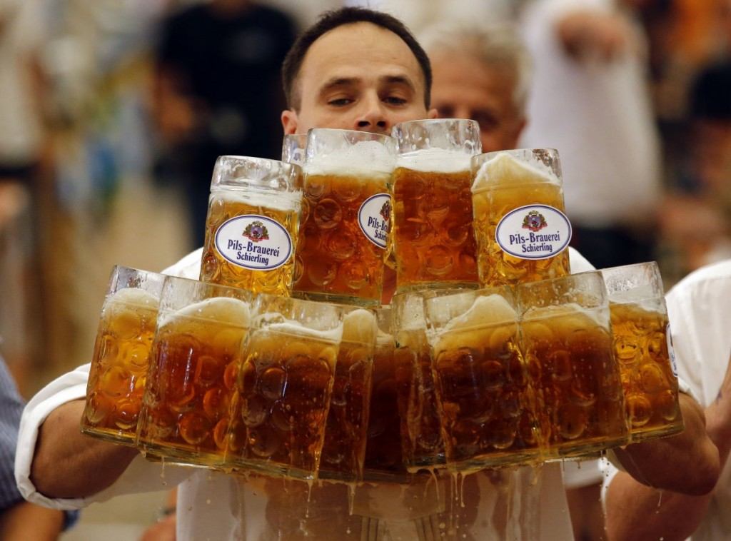 german-oliver-struempfl-competes-to-successfully-set-a-new-world-record-in-carrying-one-liter-beer-mugs-over-a-distance-of-over-131-feet-in-abensberg-germany-september-7-2014
