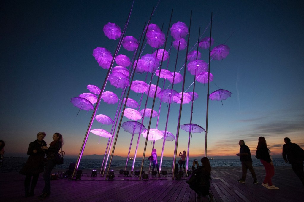 people-stand-around-umbrellas-the-sculpture-by-giorgos-zogolopoulos-as-its-illuminated-in-pink-light-to-mark-breast-cancer-awareness-month-in-thessaloniki-in-northern-greece-october-21-2014