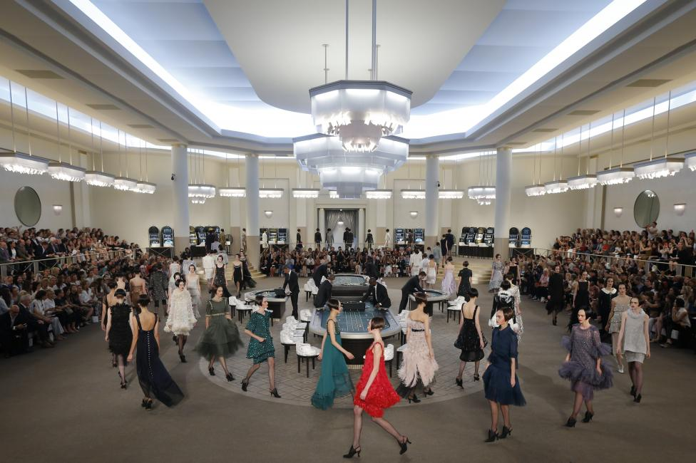 Models present creations by German designer Karl Lagerfeld as part of his Haute Couture Fall Winter 2015/2016 fashion show for French fashion house Chanel at the Grand Palais which is transformed into a casino in Paris