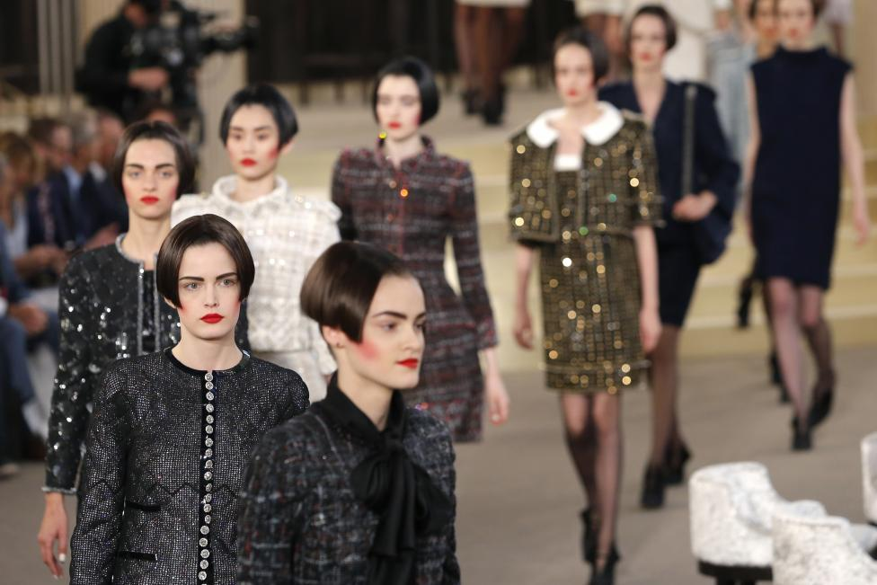 Models present creations by German designer Karl Lagerfeld as part of his Haute Couture Fall Winter 2015/2016 fashion show for French fashion house Chanel at the Grand Palais in Paris