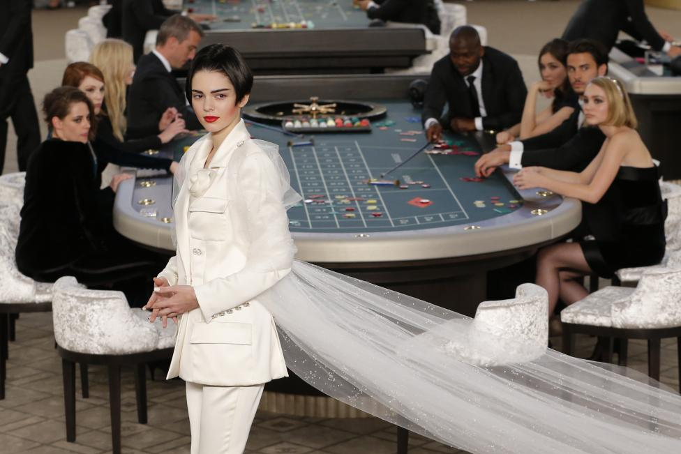 US model Kendall Jenner presents a creation by German designer Karl Lagerfeld as part of his Haute Couture Fall Winter 2015/2016 fashion show for French fashion house Chanel at the Grand Palais in Paris