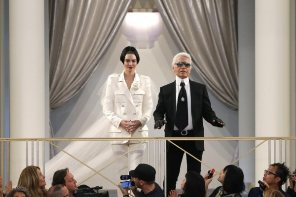 German designer Lagerfeld appears with US model Jenner at the end of his Haute Couture Fall Winter 2015/2016 fashion show for French fashion house Chanel at the Grand Palais in Paris