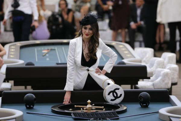 A guest poses before the Haute Couture Fall Winter 2015/2016 fashion show by German designer Karl Lagerfeld for French fashion house Chanel at the Grand Palais in Paris