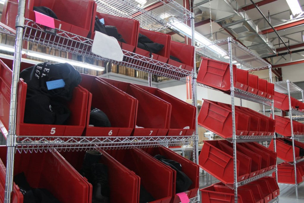 the-bags-are-then-placed-in-the-finished-row-of-shoes-these-will-be-packed-up-and-sent-back-to-customers