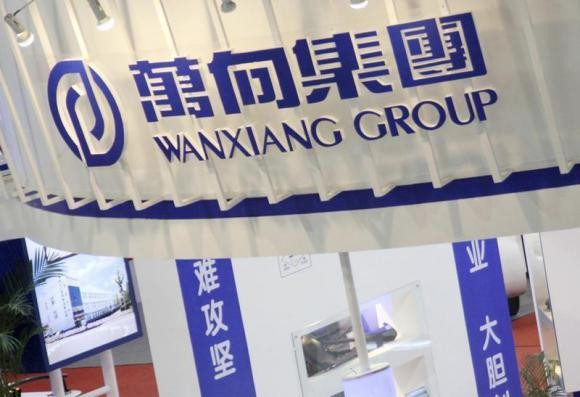 A logo of Wanxiang Group is seen at China International Auto Parts Expo in Beijing