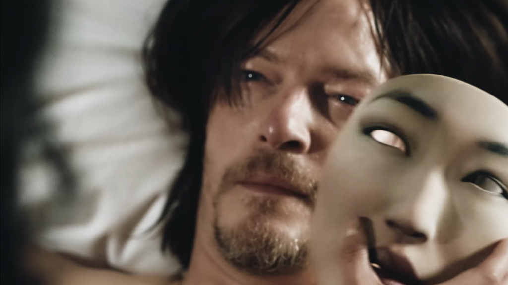 heres-reedus-as-he-appears-in-the-it-just-feels-video-next-to-him-is-one-of-ngs-3d-printed-masks