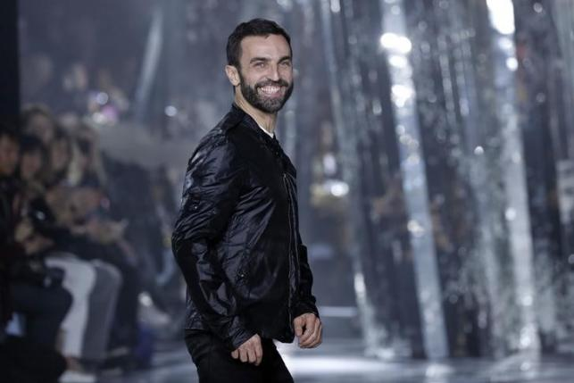 French designer Nicolas Ghesquiere appears at the end of his Fall/Winter 2016/2017 women's ready-to-wear collection show for Louis Vuitton in Paris, France, March 9, 2016. REUTERS/Benoit Tessier