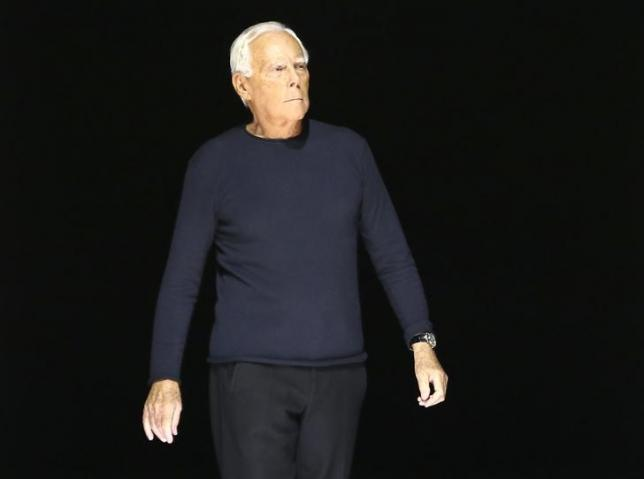 Italian designer Giorgio Armani acknowledges the applause at the end of his Autumn/Winter 2016 women's collection during Milan Fashion Week, Italy, February 29, 2016. REUTERS/Stefano Rellandini