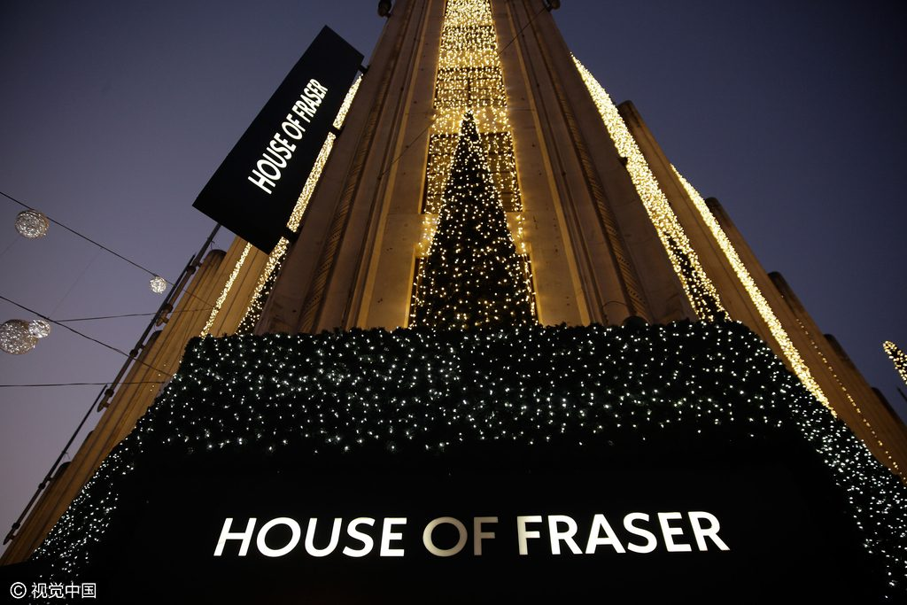 Illuminated Christmas lights and a Christmas tree sit above the entrance to a House of Fraser department store on Oxford Street in central London, U.K., on Saturday, Nov. 29, 2014. U.K. consumer confidence was unchanged this month as Britons willingness to make big purchases offset a deterioration in their outlook for the economy. Photographer: Matthew Lloyd/Bloomberg via Getty Images