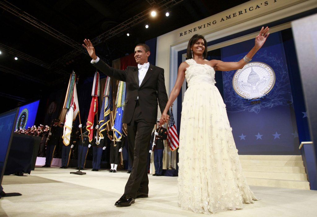 FILE PHOTO - U.S. President Barack Obama (L) walks on stage with first lady Michelle Obama during the Western States Inaugural Ball in Washington January 20, 2009. REUTERS/Jason Reed/File Photo